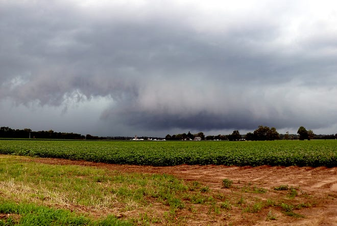 A possible wall cloud, a low-hanging, rotating anvil-shaped formation that typically precedes a tornado, is shown Saturday northwest of Findley Road near M-66. A tornado warning was declared for St. Joseph County shortly after 5 p.m.