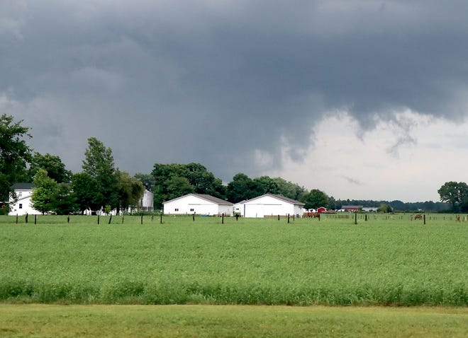 Dark thunderstorm clouds pass over eastern St. Joseph County, in this view taken Saturday on M-66 north of Sturgis.