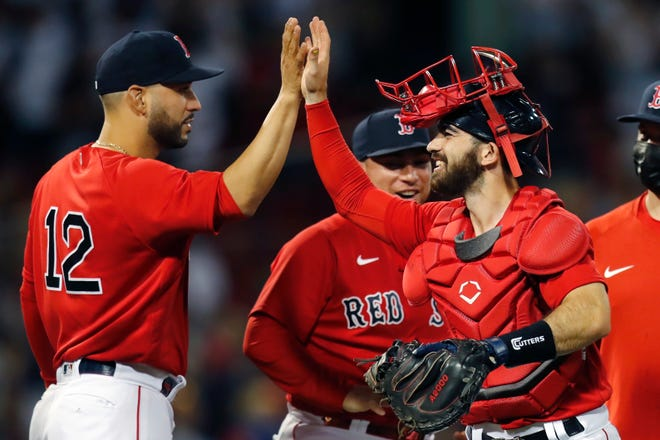 Boston Red Sox's Connor Wong, right, celebrates with Marwin Gonzalez (12) after defeating the New York Yankees at Fenway Park.