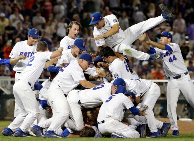 In this June 27, 2017, file photo, Florida players celebrate after defeating LSU in Game 2 to win the NCAA College World Series finals in Omaha, Neb.
