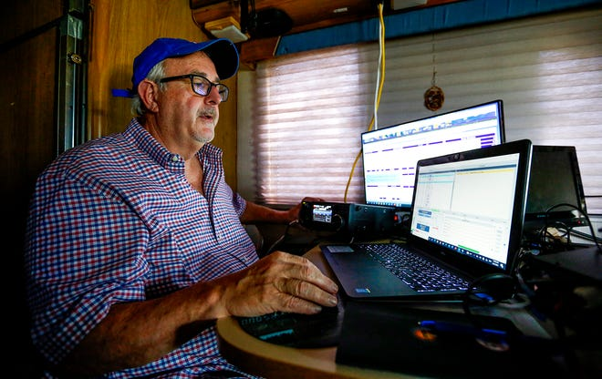 Craig Fugate, former administrator for the Federal Emergency Management Agency, sits in front of his equipment during the Amateur Radio Field Day at the Alachua County Sheriff's Office on Sunday in Gainesville.