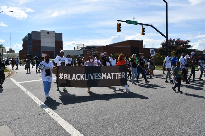 Participants from all over High Point and surrounding areas march in solidarity with the family of Fred Cox, Saturday.