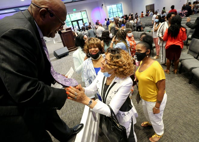 Pastor Frank Kennedy Sr. greets Dorothy Washington after the Sunday morning service. The congregation at Mount Pilgrim Baptist Church in Tuscaloosa celebrated their first church service in the new building Sunday, June 27, 2021. The church suffered a devastating fire in March of 2019 that destroyed the previous building. [Staff Photo/Gary Cosby Jr.]