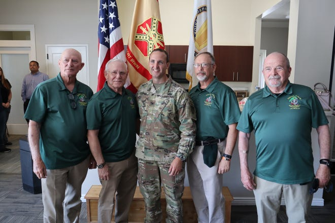 Col. Jason A. Clarke stands with members of Las Vegas-based Special Forces Association, Chapter 51 after accepting the role of garrison commander at Fort Irwin on June 25, 2021.