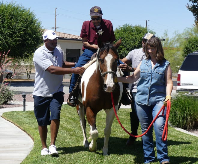 Moses Akens, 94, gets a wish granted as he rides a horse for the first time in his life outside Solstice Senior Living Community in Apple Apple Valley on Saturday, June 26, 2021.