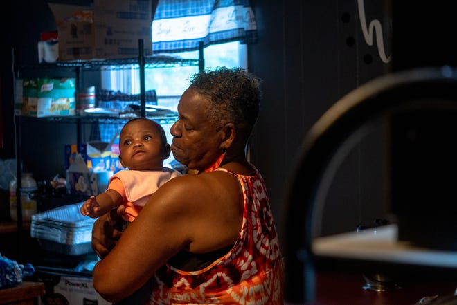 Daisy Jackson and her four-month-old great-granddaughter Denashia Zorn standing in a newly remodeled kitchen that was finished by Jackson's sons as a Mother's Day gift, June 27, 2021.