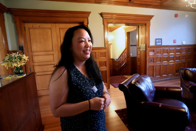 Tammie Xiong, executive director of the Hmong American Women's Association talks about moving offices to a historic mansion at 3030 W. Highland Blvd. on Friday, June 25, 2021. The group hopes the new office will allow them to better serve Hmong and other Southeast Asian women, girls and queer people. The office is close to shelter services for domestic violence victims and is in a central location for populations spread across the city, with many Hmong in the city's northwest side and Burmese refugees on the city's south side.