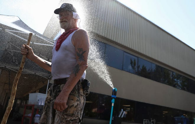 David Boone cools off at The Arches Project cooling station in Salem, Oregon on Saturday, June 26, 2021. Temperature rose into the triple digits Saturday in Salem and across the Pacific Northwest.