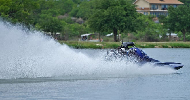 A competitor speeds down Lake Nasworthy during the Drag Boat Races Showdown on Saturday, June 26, 2021.