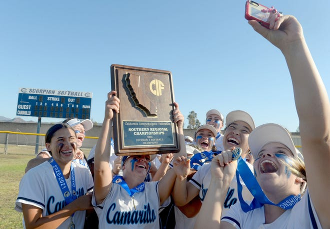 Camarillo High softball players take a selfie with the championship plaque after the Scorpions beat visiting Westlake 2-0 in the final of the CIF-State Division I SoCal Regional on Saturday, June 26, 2021.