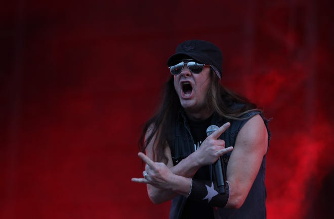 Johnny Solinger, seen here performing at Pentaport Rock Festival in South Korea on Aug, 2, 2013, has died at 55.