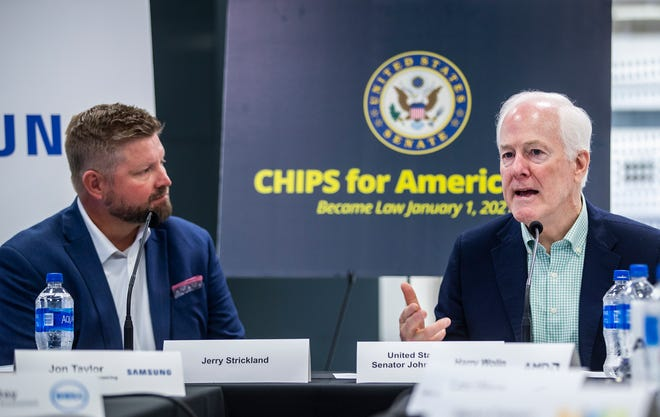 Sen. John Cornyn, right, speaks at a Monday news conference at the Samsung facility in Austin. Joining Cornyn is Jerry Strickland, executive director of the FABSSTexas Coalition, a group of semiconductor manufacturing companies.