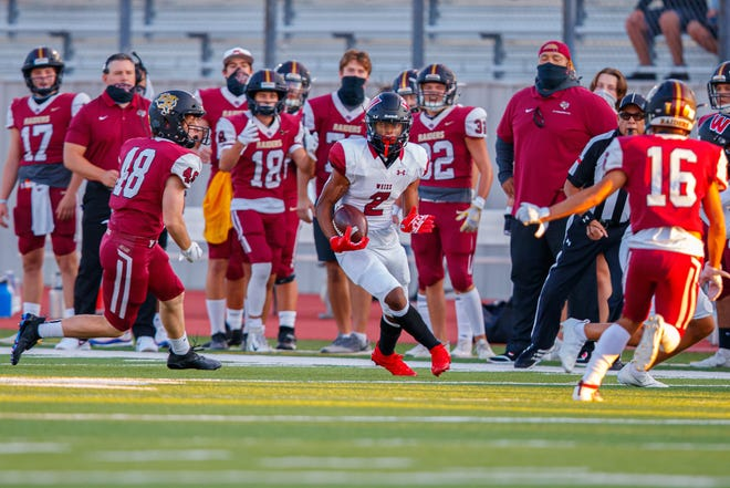 Weiss wide receiver Tavian Cord, center, gets loose downfield against Rouse in a game last season. A bona-fide Division I prospect, Cord already holds an offer from UNLV with several other colleges close to pulling the trigger on the young playmaker.