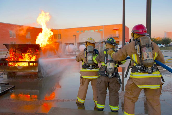 Del Mar Fire Academy students exist a live burn during academy fire training last year.