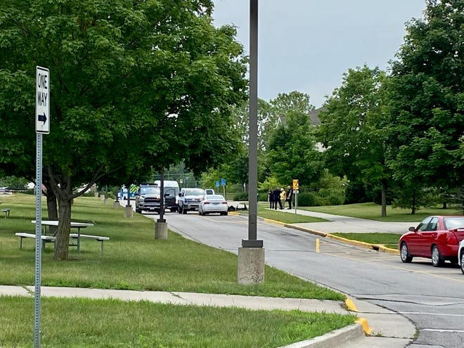 Officials investigate a suspicious package in Frederiksen Court on Monday, June 28, 2021 on the Iowa State University campus in Ames, Iowa.