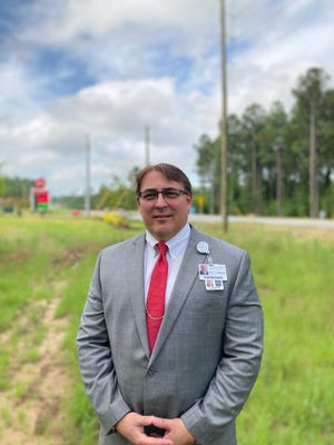 Scott Ansede, chief operating officer for University Health Care Physicians, stands on the site of what will become a new clinic to serve the growing area of Harlem and Appling in Columbia County.