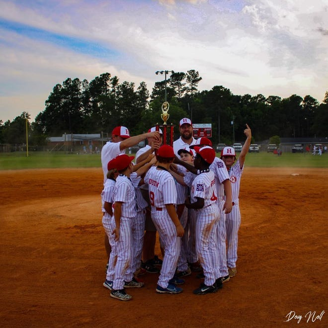 The H.C. Dixie Youth Minors celebrate after winning the District Tournament.