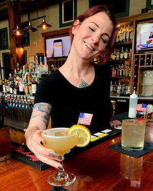 Bartender Alley Atkinson serves up the special Fourth of July cocktail, Loyal to None, at Hops/Scotch in Doylestown.