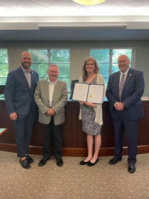 The Beaver County Commissioners recently issued a proclamation celebrating the 50th anniversary of the Beaver County Library System, which was first formed in 1971. Pictured, from left to right, are Commissioners Daniel C. Camp, III, and Tony Amadio, Library System Director Jodi Oliver, and Commissioner Jack Manning.