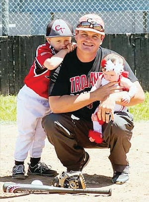 Caney Valley High head baseball coach Shayne Cramer, center, poses in 2017 with his children Easton, left, and Rylee. He is married to former Barnsdall High student-athlete standout Aubrey Hibdon. Cramer has decided to step away from coaching in order to devote more time to his children.