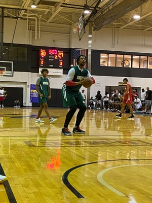Jared Sullinger attempts a free throw as teammate Meechie Johnson Jr. watches during a Kingdom Summer League game at Ohio Dominican on Sunday.