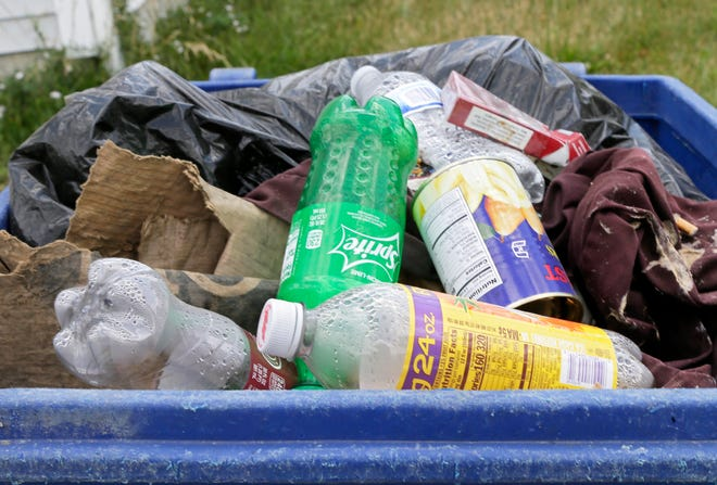 A file photo showing recycling containers on the South Side of Columbus. A new program is being rolled out in partnership between Solid Waste Authority of Central Ohio and the city of Columbus to increase recycling participation rates in Hilltop neighborhoods on the West Side.