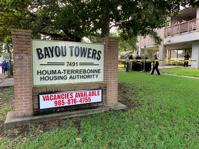Police respond to the scene late this afternoon after authorities say a man jumped from the 11th floor of the Bayou Towers Apartment Complex in Houma.