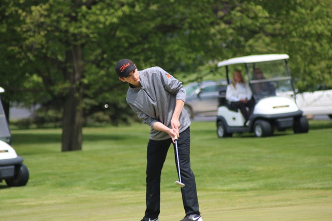Tecumseh's David Clarke putts during the Lenawee County Tournament at Tecumseh Golf Club on Monday, May 10.