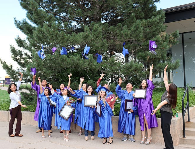 The Dodge City Community College Adult Learning Center hosted its Class of 2021 graduation ceremony on Friday, June 25, at 6 p.m., in the DCCC Little Theatre. A total of 14 students received high school diplomas, although not all were in attendance. Above, following the ceremony and reception, graduates throw their caps in the air in front of the Little Theatre.