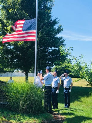 The Williamson County Civil Air Patrol Color Guard conduct a retirement ceremony for an American flag at Willow Springs Assisted Living and The Arbors Memory Care in Spring Hill, Tenn., Monday, June 14, 2021.