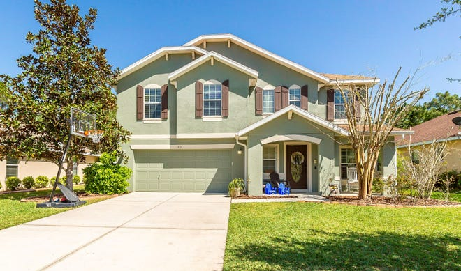 Whether you're looking for extra space in your living areas, kitchen, pantry, closets or backyard, this updated home in the Cypress Place area of Hunters Ridge has it.