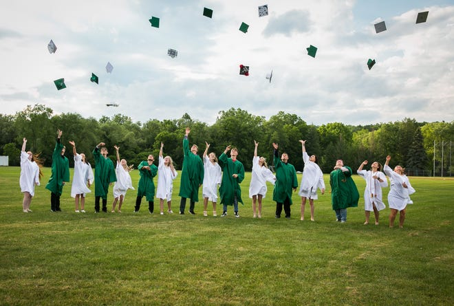 The Canaseraga Central School Class of 2021 throws their graduation caps in the air after 16 graduates received their diplomas.