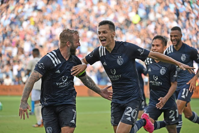 Sporting Kansas City forward Daniel Salloi (20) celebrates with teammates after scoring a goal during the second half against Los Angeles FC Sunday at Children's Mercy Park. Salloi's seventh goal of the season lifted Sporting to a 2-1 victory.
