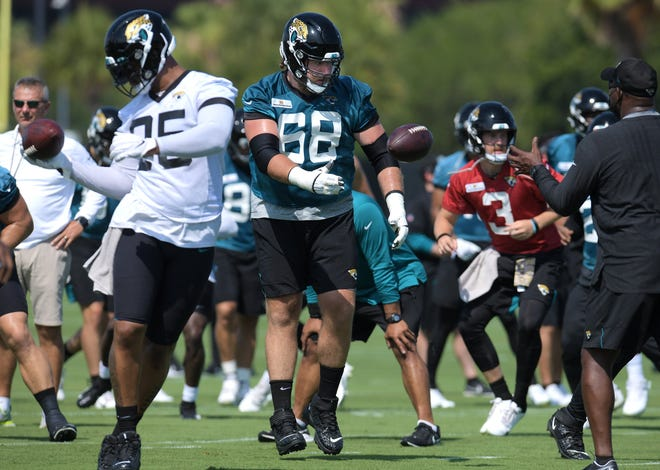 Jaguars guard Andrew Norwell has a ball thrown to him as he runs through drills during minicamp in June.