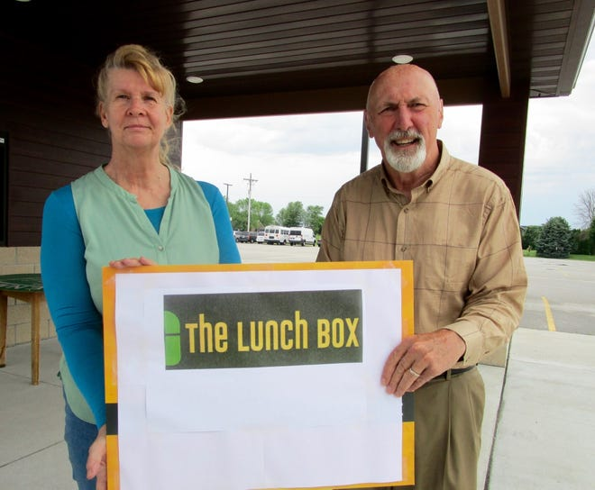 """Linda Flatt and Brent Boxell are in charge of the """"The Lunch Box"""" program which provides lunches for young people in Geneseo and surrounding communities. The program begins Wednesday, July 7, at the Geneseo High School tennis courts."""