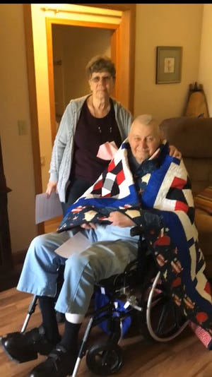 Pictured is Mary Rice, left presented  the  Quilt of Valor to Harland Nelson, right  formerly of Galva  for his military service.  The Quilt of Valor is a Civilian Award for the individuals service and sacrifice to defend our Country's freedoms