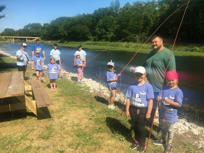 These 2nd and 3rd grade Girl Scout Brownies and volunteers recently enjoyed a morning of fishing on the canal at the Geneseo Ikes Park.