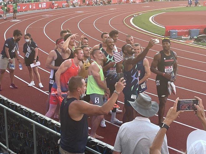 Will Daniels, in the yellow Iowa shirt, is shown with the entire decathlon group at the Olympic Trials in Eugene, OR, after the 1500 run. The photo includes the three athletes that will be going to Tokyo.