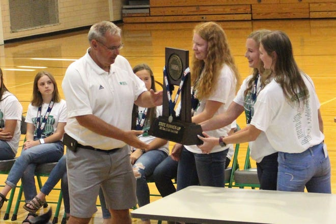 The Geneseo Girls' Track and Field team recently held their end-of-season awards event and presented GHS Principal Travis Mackey with the trophy they received at the IHSA 2A State Finals held at Eastern Illinois University in Charleston. With Mackey are from left, Alison Bowers, Evie Wilson and Esther Brown.