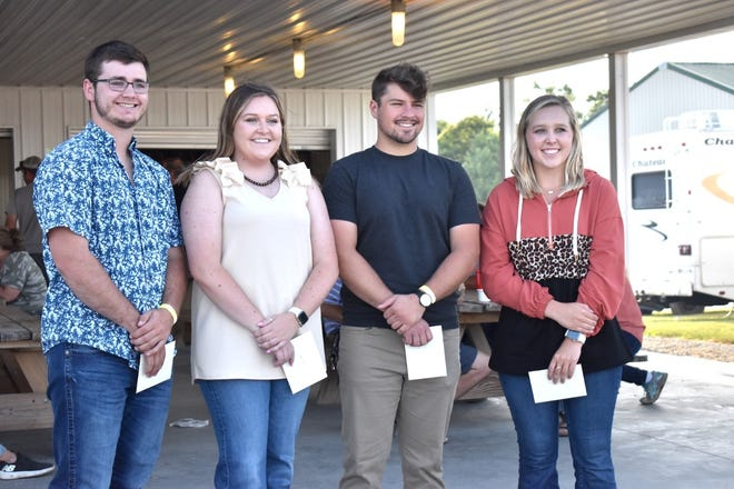 Wilbert and Carol Keppy Charitable Foundation Scholarships were presented Wednesday, June 23, to four students, including, from left, Austin Reed, Jaidyn Miller, Matthew Engnell and Fayth Koning Park, at the Henry County Pork Producers pavilion on the fairgrounds in Cambridge. Also receiving scholarships are Kade Buysse, Lauren Curry and McKenzie Davison.