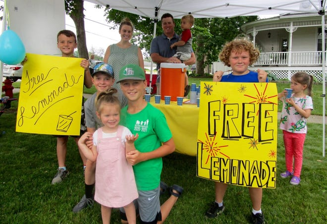 Grace in Action included serving free lemonade to passersby from a stand at the corner of College Ave. and 2nd St. The group includes, from left, Bennett Mickley, Mark Shoemaker, Claire Rushing, Wyatt Mickley, Ryan Coleman, Eliza Shoemaker; in back Jenna Rushing, James Mickley and Bodey Mickley.