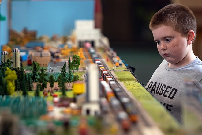 Xander Otake, 10, of DeKalb gets a closeup look at a model train at the Heritage N-Track Group model railroad during the Galesburg Railroad Days Model Train & Railroadiana Showcase at the Knox College T. Fleming Fieldhouse on Saturday.