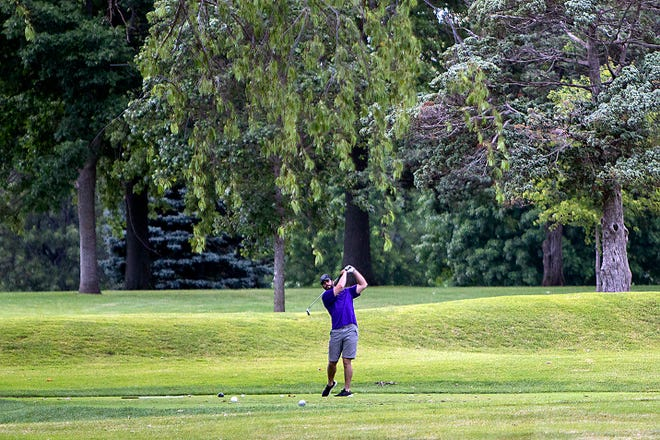 Ian Milligan of Galesburg watches his drive from the 13th tee at Bunker Links Municipal Golf Course on Sunday, June 27, 2021.