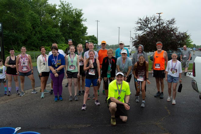 """""""Pittsford Firecracker"""" runners gather for a photo after the running events."""