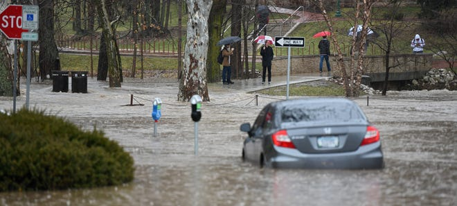 The Jordan River flowed over its banks at Dunn Meadow on Feb. 7, 2019, and closed the intersection at Indiana Avenue and Sixth Street.