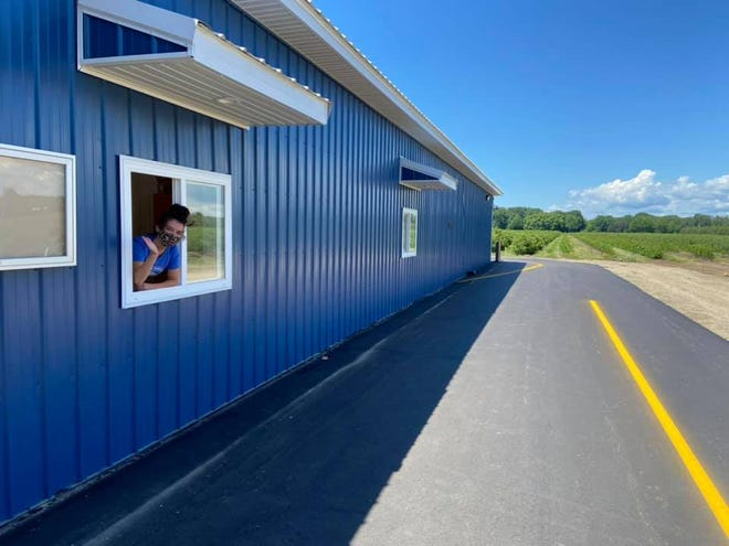 The expanded farm market at Bowerman Blueberries offers drive-thru and walk-up window service, additional parking spaces, convenient shopping hours and a variety of local products, including baked goods, fresh produce and apparel.