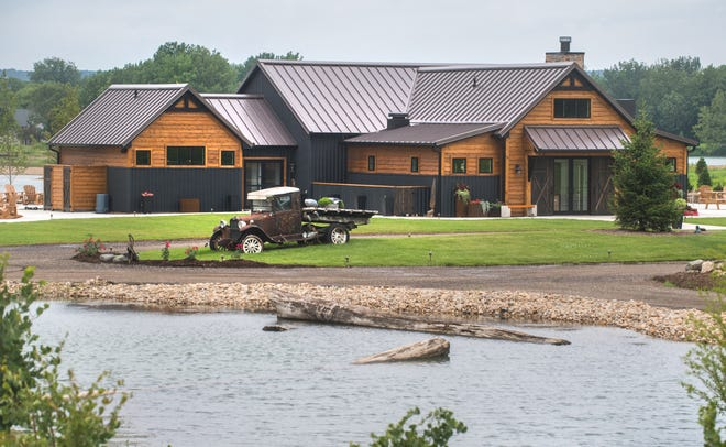 An antique car sits outside the new Woolly Bugger Restaurant at the Sankoty Lakes Resort and Retreat in Spring Bay.