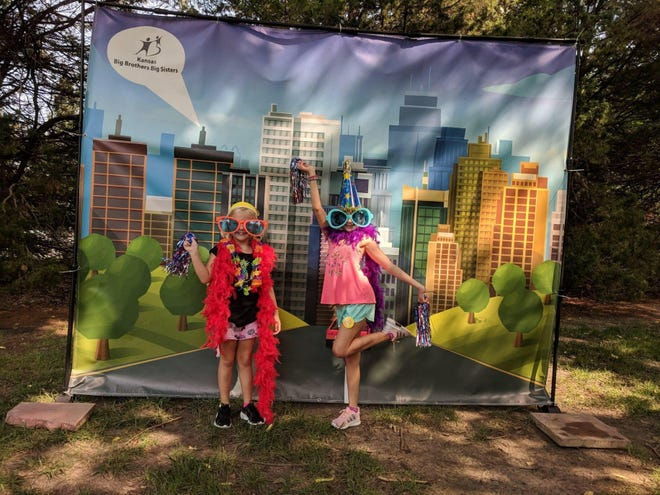 Children get a fun photo taken at previous Sand Creek Summer Daze Festival. The Festival will kick off this week, before roaring into high gear July 9.