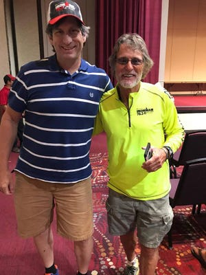 Mike Greer, right, pictured with William Pruett, a participant in the first Buffalo Springs Lake Triathlon. Greer, the event founder in 1990, died Wednesday from injuries he suffered in a motorcycle accident June 27, shortly before IRONMAN 70.3 Lubbock.