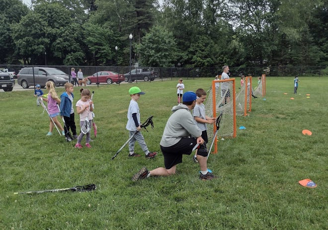 U7 sticks-only players are coached during the last session of their season.